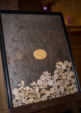 wood-chips-filling-frame-of-wedding-guest-book