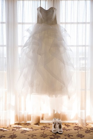 reem-acra-ball-gown-with-a-ruffled-tulle-skirt-in-window-with-aquazarra-shoes