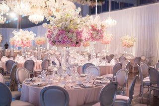 wedding-reception-white-drapery-pink-linen-flower-centerpieces-silver-chairs-tall-flower-chandelier