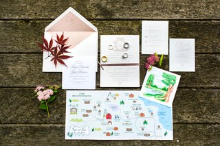 wedding-invitation-suite-with-custom-ceremony-program-painting-and-map-with-activities-for-area