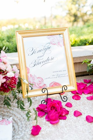 wedding-anniversary-and-vow-renewal-sign-with-pink-roses-and-gold-frame-sequin-table