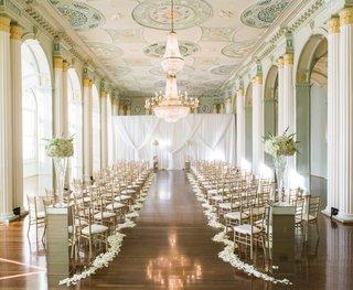 wedding-ceremony-at-the-biltmore-ballrooms-in-atlanta-flower-petals-along-aisle
