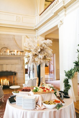 strolling-wedding-reception-cocktail-hour-appetizers-arrangement-of-gold-dipped-feathers