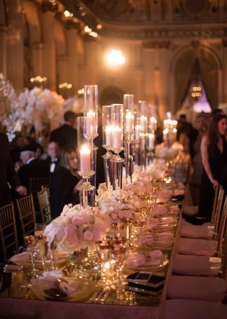 wedding-reception-long-rectangle-table-mirror-top-low-flower-centerpiece-tall-candles-candlelight