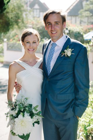 couple-blue-white-pose-tie-checkered-oceanside-california-wedding-suzanne-neville-beach-wedding