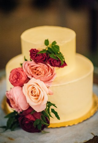 two-layer-buttercream-toned-wedding-cake-with-pink-and-red-roses