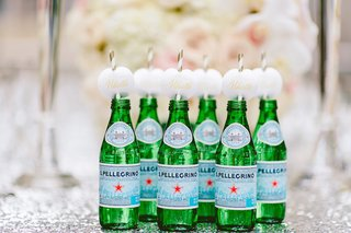 wedding-reception-with-s-pellegrino-bottles-gold-white-straws-wet-your-whistle-labels