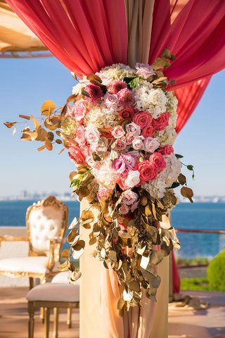 white-pink-rose-hydrangea-flowers-gold-leaves-red-and-gold-drapery