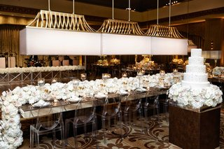 chicago-hotel-wedding-reception-ghost-chairs-long-overflowing-white-hydrangea-rose-orchid-flowers
