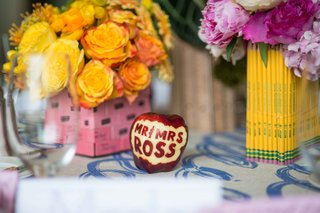 pink-eraser-and-pencil-vases-yellow-pink-flowers-bridal-shower-school-theme-carved-apple