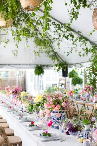 chinoiserie-vases-pink-and-yellow-flowers-kings-table-for-tented-rehearsal-dinner-with-flowers