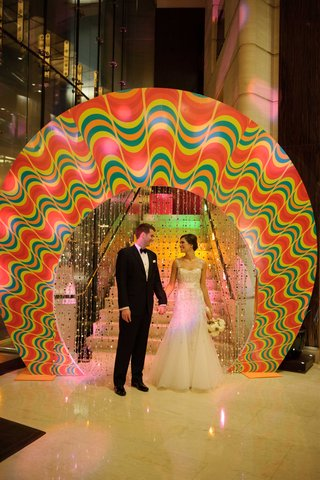 bride-in-monique-lhuillier-wedding-dress-and-groom-in-tuxedo-at-trump-hotel-chicago-fun-wheel-entry
