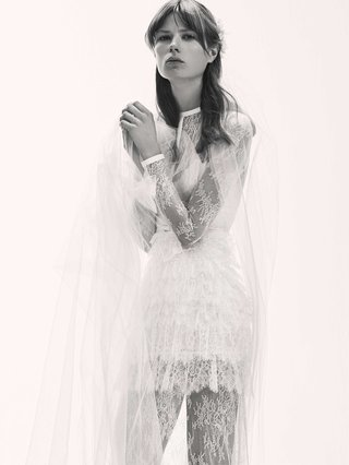 black-and-white-photo-of-elie-saab-bridal-spring-2017-ruffle-short-wedding-dress-long-sleeve-high