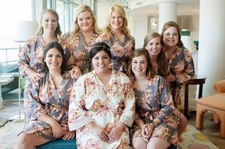 bride-in-white-flower-print-robe-with-lace-hem-and-bridesmaids-in-grey-robes-with-flower-print