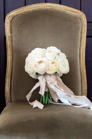 wedding-bouquet-with-white-roses-tied-with-pink-ribbon
