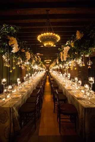 wedding-reception-two-long-reception-kings-tables-with-candles-on-table-and-flower-arrangements