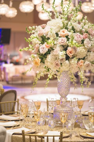 wedding-reception-table-with-cut-crystal-vase-full-of-white-hydrangeas-orchids-pink-light-purple