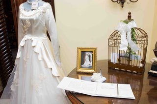 guest-book-with-antique-wedding-dress-and-family-photo