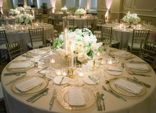 low-floral-centerpiece-with-white-flowers-with-tapered-candles