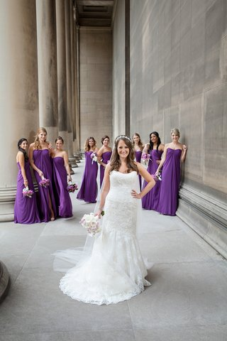 bride-in-front-of-bridesmaids-in-purple-gowns