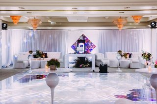dj-booth-and-lounge-furniture-at-dancing-after-party-spot-reception-white-purple-chandeliers