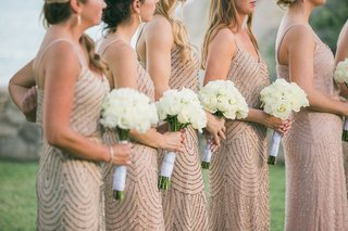 bridesmaids-holding-simple-white-bouquets-wearing-champagne-colored-dresses-silver-embellishments