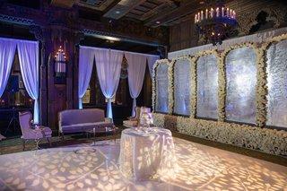 wedding-reception-styled-shoot-lounge-area-cake-table-foliage-motif-on-dance-floor-flower-wall
