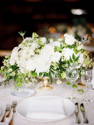 wedding-reception-short-flower-centerpiece-white-blooms-greenery-gold-vessel-footed