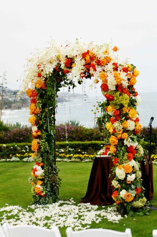 wedding-arch-with-read-orange-and-white-florals-and-crystal-details