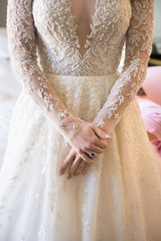 wedding-dress-reem-acra-sapphire-ring-with-illusion-sleeves-and-bodice-with-sparkles-white-manicure