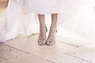 bride-wearing-strappy-sandal-wedding-heel-shoes-by-badgley-mischka-and-french-manicure-pedicure