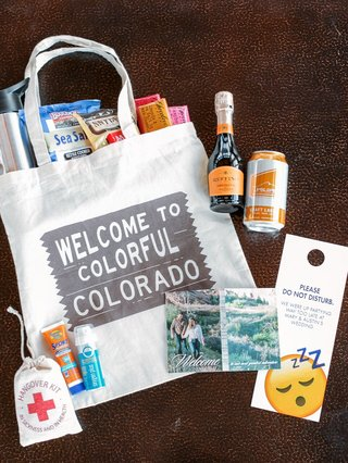 welcome-bag-for-colorado-wedding-with-snacks-emergency-kit-do-not-disturb-door-tag