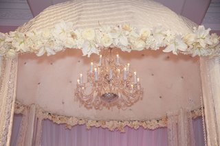 crystal-chandelier-inside-tufted-velvet-canopy