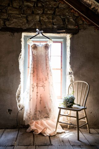 wedding-dress-in-rustic-window-with-embroidery-and-lace-straps