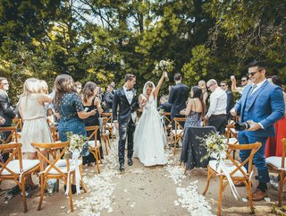 outdoor-wedding-among-the-trees-in-napa-celebrating-newlyweds-in-recessional