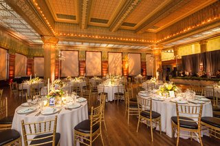 wedding-reception-gold-ballroom-art-institute-of-chicago-round-table-gold-chairs-black-cushions