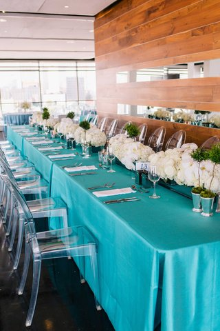 detriot-lions-quarterback-matthew-stafford-rehearsal-dinner-tiffany-blue-linens-ghost-chair-flowers