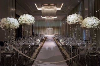 chicago-ballroom-ceremony-venue-chandeliers-white-flowers-orchids-roses-hydrangea-round-back-chairs