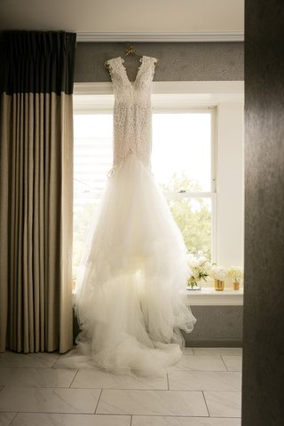 beaded-berta-mermaid-wedding-dress-in-front-of-window