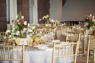 wedding-reception-table-with-small-arrangement-of-pink-white-and-green-flowers