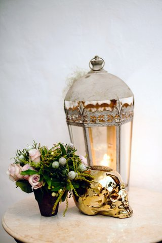white-lantern-with-pink-rose-arrangement-and-metallic-gold-skull