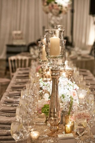wedding-reception-long-table-with-runner-gold-candle-votive-and-white-pink-flowers