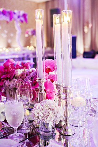 hydrangea-orchid-rose-purple-low-centerpieces-with-taper-candles-on-top-of-silver-candlesticks