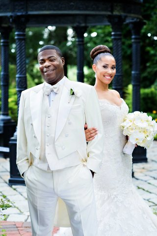 tracy-morgan-in-white-tail-tuxedo-and-megan-wollover-in-ines-di-santo-wedding-dress-white-bouquet