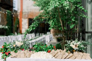rose-petals-in-paper-bags-for-guests-to-toss-at-newlyweds