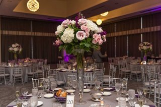 wedding-reception-silver-chairs-purple-lighting-grey-linen-white-hydrangea-pink-rose-centerpiece