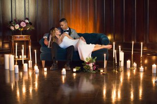 bride-groom-lounging-candles-styled-shoot-wedding-after-party-sexy-dress-valentina-kova-honeymoon
