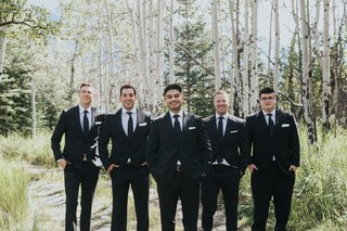 groom-in-ermenegildo-zegna-and-groomsmen-in-black-suits-among-birch-trees-in-banff