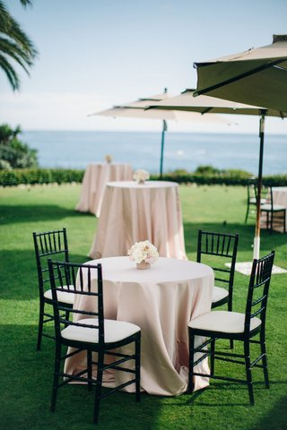 pink-cocktail-tables-on-grass-lawn-with-ocean-view