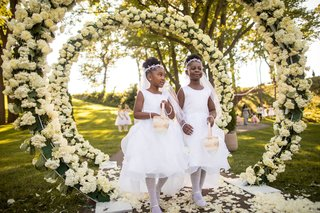 outdoor-wedding-ceremony-ghana-african-royalty-ivory-hydrangea-greenery-circle-arch-outdoor-ceremony